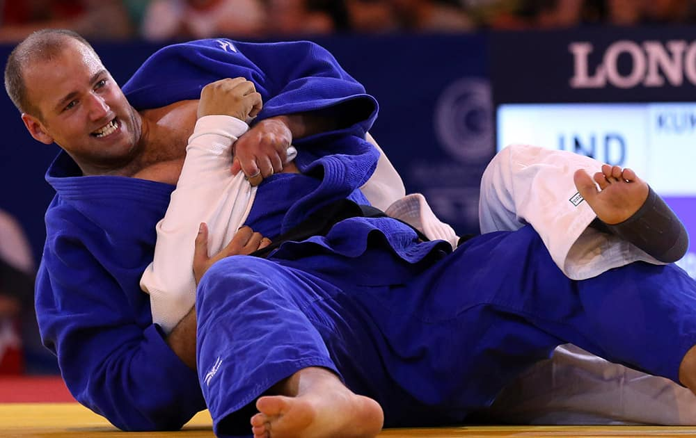 India's Parikshit Kumar and Australia's Jake Andrewartha, left, fight during the Men's +100kg judo bronze medal bout at the Commonwealth Games 2014 in Glasgow, Scotland.