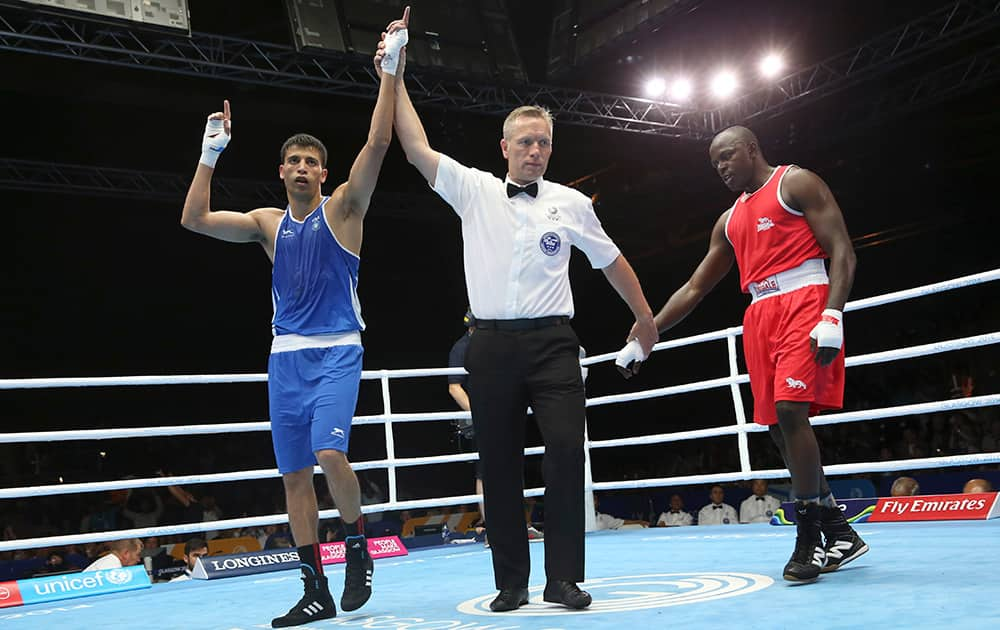 India's Sumit Sangwan celebrates after defeating Tanzania's Mohamed Hakimu Fumu in their men's light heavywight boxing preliminary match at the Commonwealth Games Glasgow 2014, in Scotland.