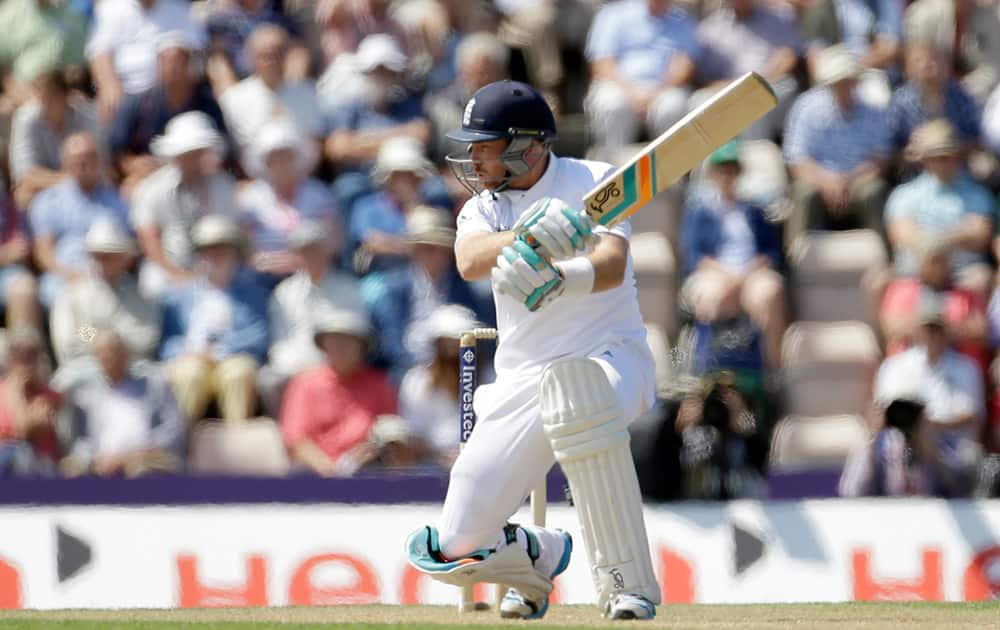 England's Ian Bell crouches down after playing a shot during the second day of the third cricket test match of the series between England and India at The Ageas Bowl in Southampton, England.