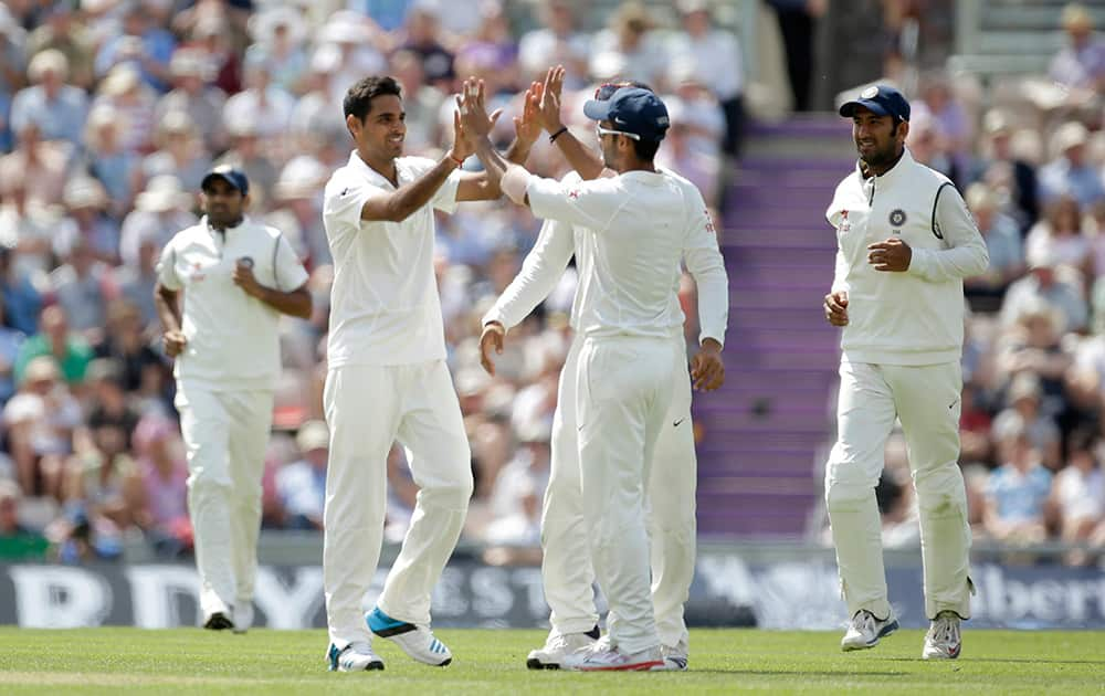 India's Bhuvneshwar Kumar celebrates taking the wicket of England's Joe Root during the second day of the third cricket Test match of the series between England and India at The Ageas Bowl in Southampton, England.