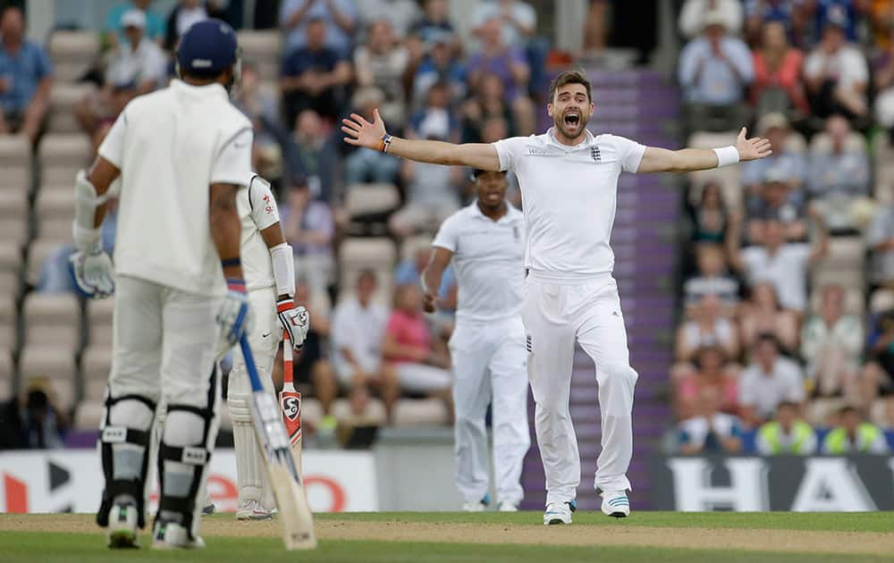 England's James Anderson, right, makes an unsuccessful wicket appeal for India's Cheteshwar Pujara, second left obscured, during the second day of the third cricket test match of the series between England and India at The Ageas Bowl in Southampton.