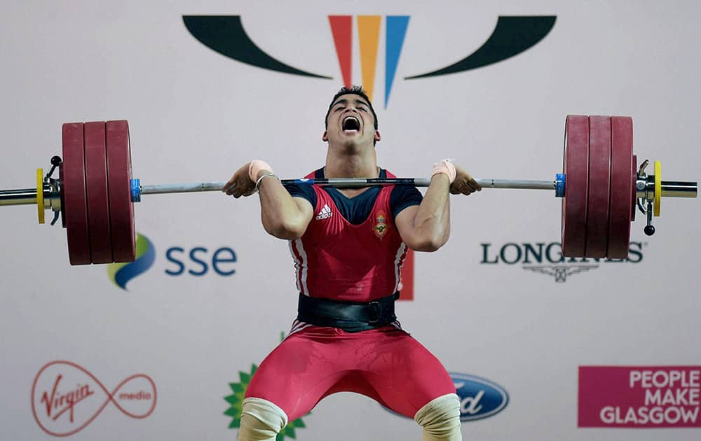 India's Vikas Thakur lifts on his way to win silver in the Men's Weightlifting 85kg category event at Scottish Exhibition and Conference Centre at the Commonwealth Games 2014 in Glasgow.