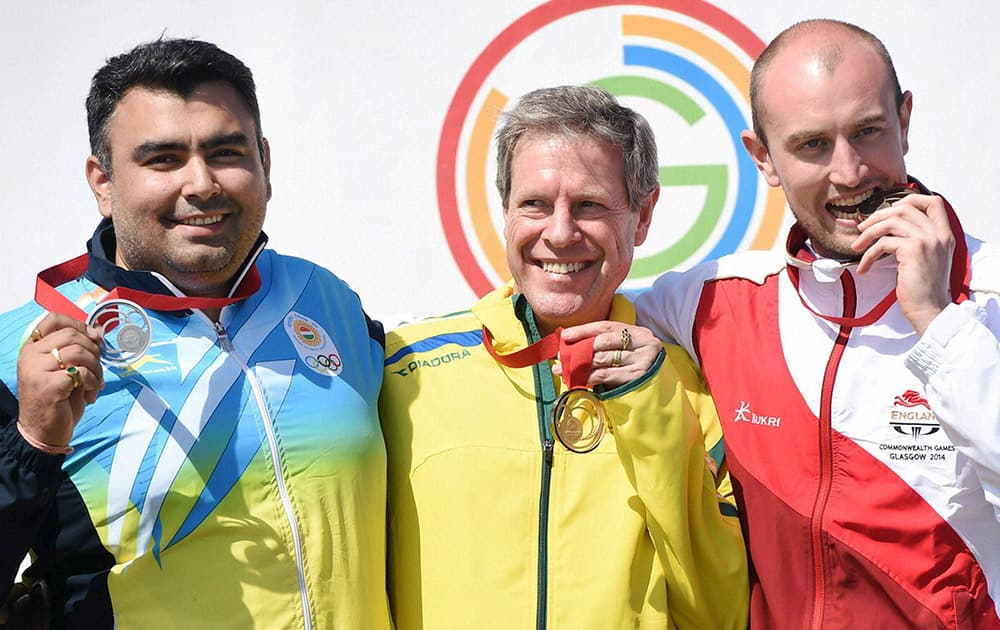 Silver medallist Gagan Narang, Australia's Gold Medallist Warren Potent and England's Kenneth (bronze) during the medal ceremony of the 50m Rifle Prone men final event during the Glasgow 2014 Commonwealth Games at Barry Buddon Shooting Centre in Glasgow.