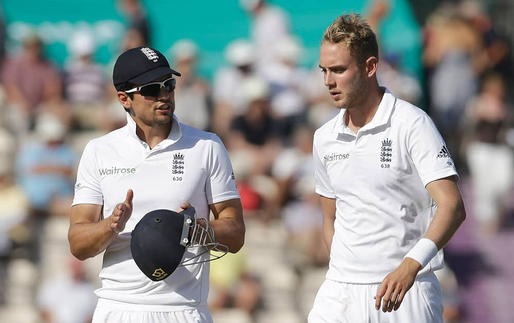 England captain Alastair Cook, left, talks with Stuart Broad before Broad bowled an over during the third day of the third cricket Test match of the series between England and India at The Ageas Bowl in Southampton.