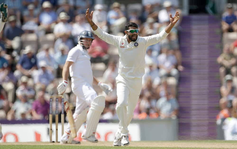 India's Ravindra Jadeja successfully appeals for the wicket of England's Gary Ballance during the fourth day of the third cricket test match of the series between England and India at The Ageas Bowl in Southampton, England.