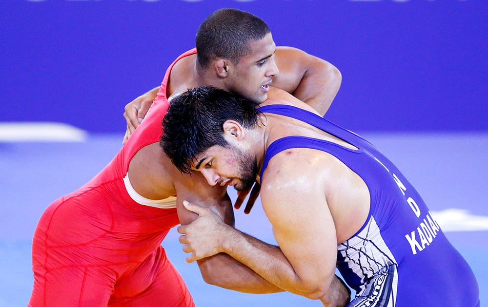 England's Leon Rattigan and India's Satywart Kadian challenge during the freestyle 97kg semifinal wrestling at the Commonwealth Games Glasgow 2014, in Glasgow, Scotland.
