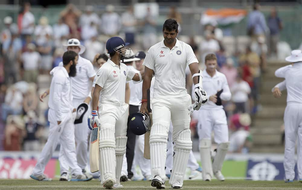 India's Ajinkya Rahane and Pankaj Singh walk off the field of play after being defeated by England after the last wicket fell of Rahane bowled out by England's Moeen Ali on the fifth and final day of the third cricket test match at The Ageas Bowl in Southampton, England.