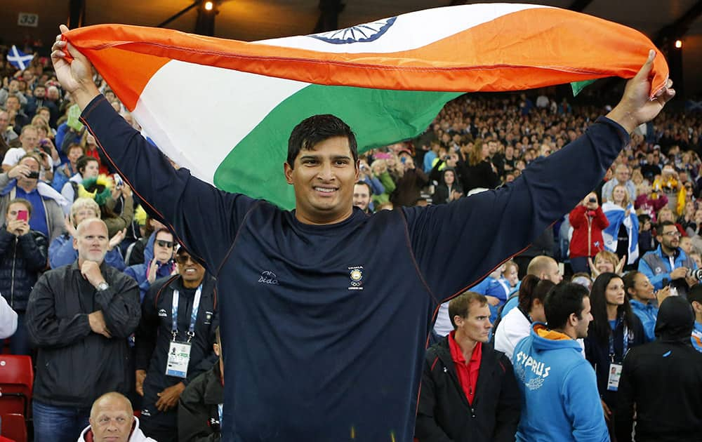 Vikas Shive Gowda of India celebrates after winning the men's discus final at Hampden Park Stadium during the Commonwealth Games 2014 in Glasgow.