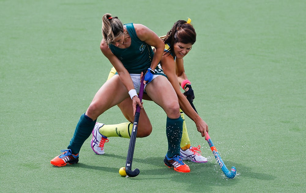 Australia's Anna Flanagan, right, vies for the ball with South Africa's Dirkie Chamberlain during their women's semi final hockey match during the Commonwealth Games 2014 in Glasgow, Scotland.