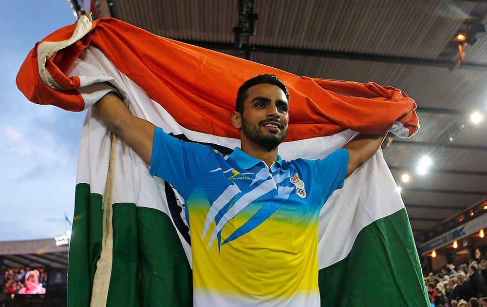 India's Arpinder Arpinder Singh celebrates after the final of the Men's triple jump at Hampden Park Stadium during the Commonwealth Games 2014 in Glasgow, Scotland.