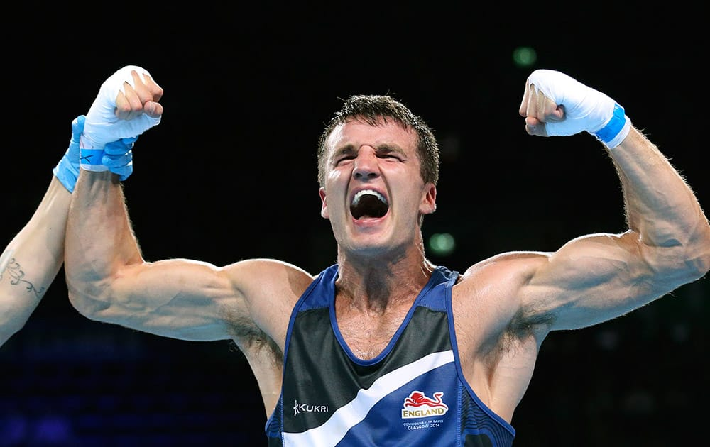 England's Anthony Fowler celebrates after defeating India's Vijender Vijender in their men's middle 75kg boxing final during the 2014 Commonwealth Games in Glasgow, Scotland.