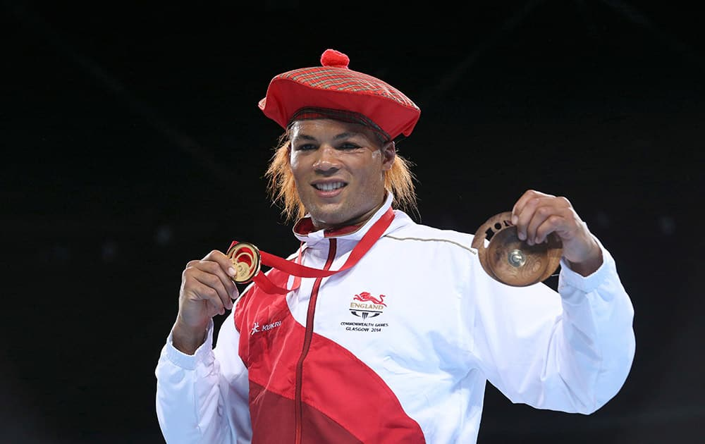 Gold medal winner Joseph Joyce from England poses during the medals ceremony after defeating Australia's Joseph Goodall in the men's super heavyweight boxing final at the 2014 Commonwealth Games in Glasgow, Scotland.