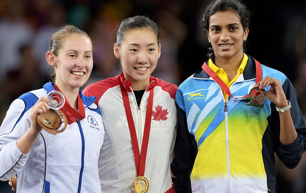 India's Bronze Medallist P V Sindhu, Scotland's Silver medallist Kirsty Gilmour (L) and Canada's Gold medallist Michelle Li after the medal ceremony of Women's Single Badminton final match at Commonwealth Games 2014 in Glasgow, Scotland.