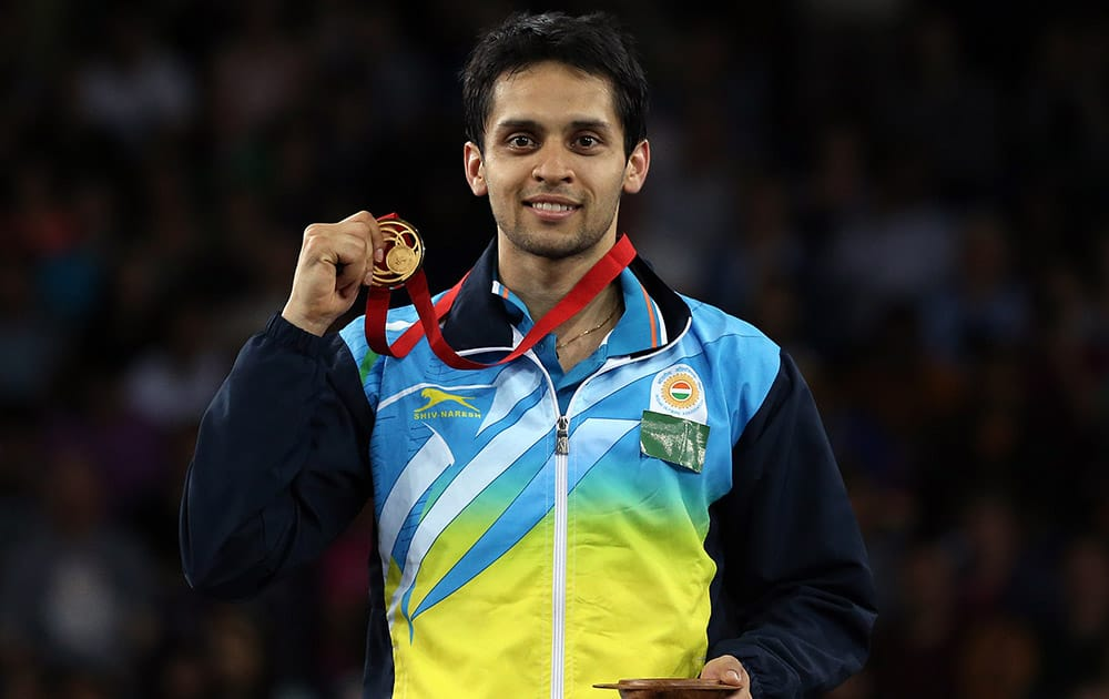 India's Kashyap Parupalli poses with his gold medal after his victory over Singapore's Derek Wong at the end of their men's single's Badminton match at the Emirates Arena during the Commonwealth Games Glasgow 2014.