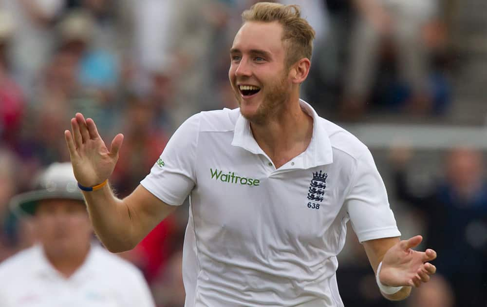 England's Stuart Broad celebrates after taking the wicket of India's Cheteshwar Pujara for 0 at Old Trafford cricket ground on the first day of the fourth test match of their five match series, in Manchester, England.