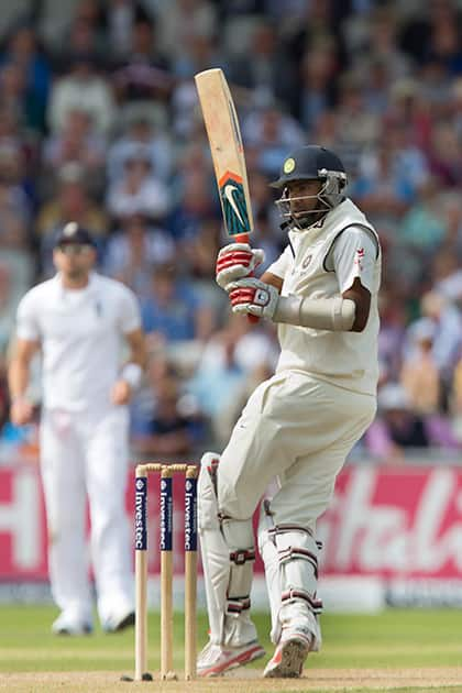 Ravichandran Ashwin watches a shot off the bowling of England's Chris Woakes at Old Trafford cricket ground on the first day of the fourth test match of their five match series, in Manchester, England.