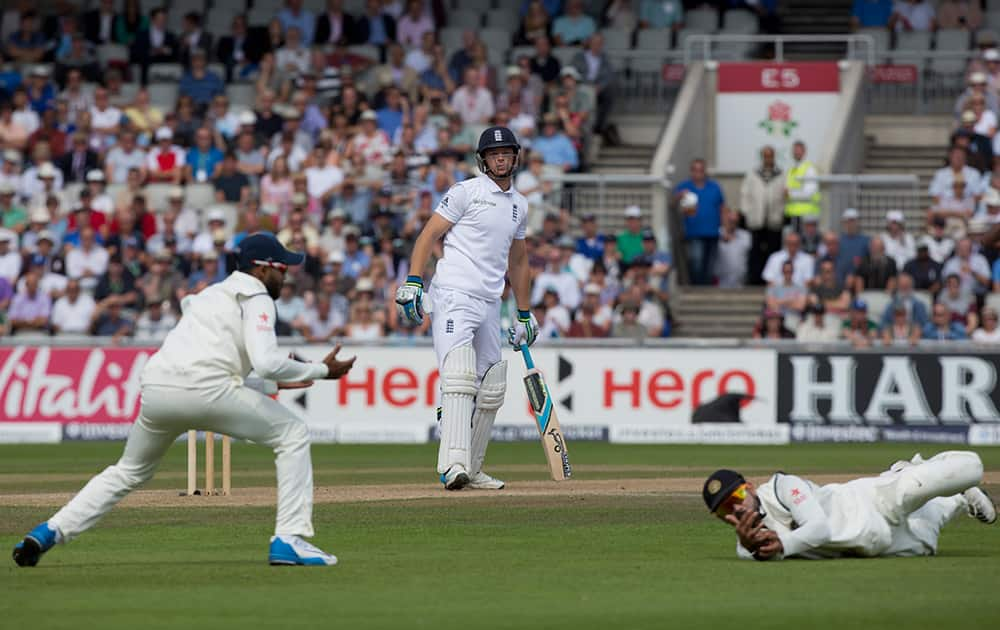 England's Jos Buttler survives a catching attempt by India's Virat Kohli on the third day of the fourth test match of their five match series at Old Trafford cricket ground, in Manchester, England.