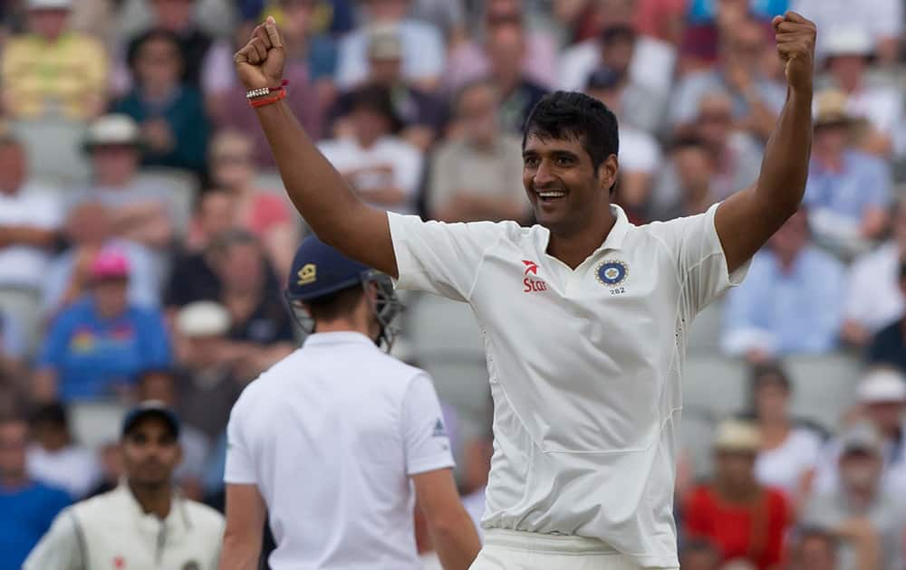 India's Pankaj Singh celebrates after taking the wicket of England's Jos Buttler, caught by Cheteshwar Pujara for 70, on the third day of the fourth test match of their five match series at Old Trafford cricket ground, in Manchester, England.