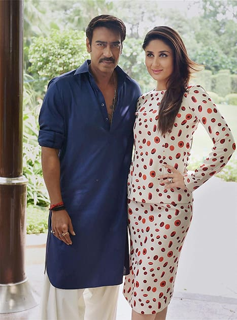 Kareena Kapoor and Ajay Devgn posing during a promotional event of their film.