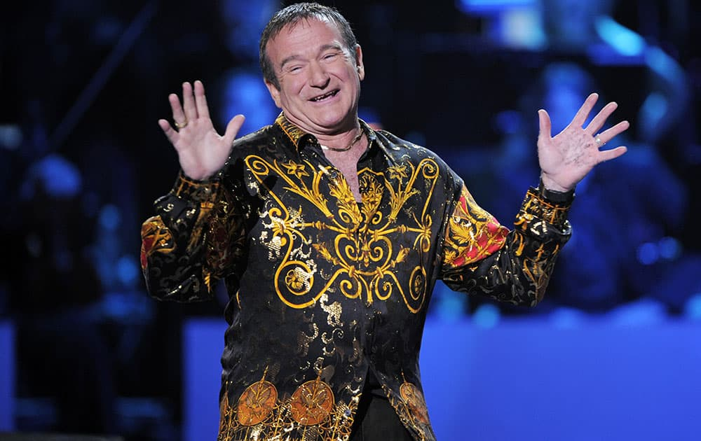 FILE - This April 6, 2008 file photo shows actor-comedian Robin Williams speaks on stage at the 'Idol Gives Back' fundraising special of `American Idol` in Los Angeles. Williams, whose free-form comedy and adept impressions dazzled audiences for decades, has died in an apparent suicide.