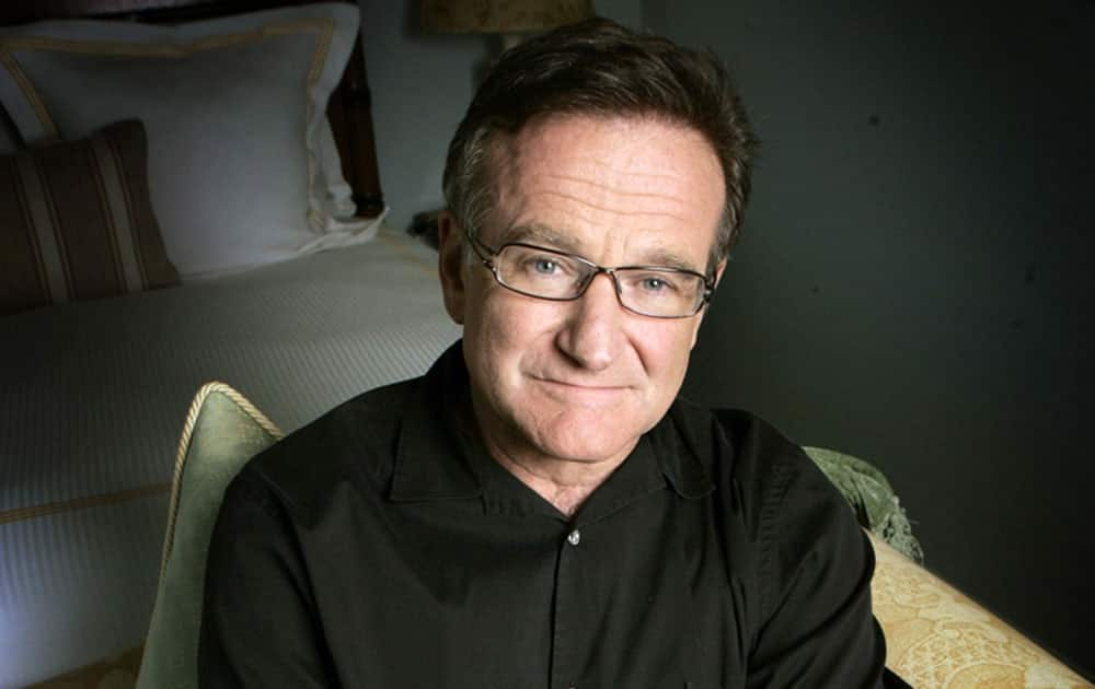 FILE - This June 15, 2007 file photo shows actor and comedian Robin Williams posing for a photo in Santa Monica, Calif. Williams, whose free-form comedy and adept impressions dazzled audiences for decades, died Monday, Aug. 11, 2014, in an apparent suicide. Williams was 63.