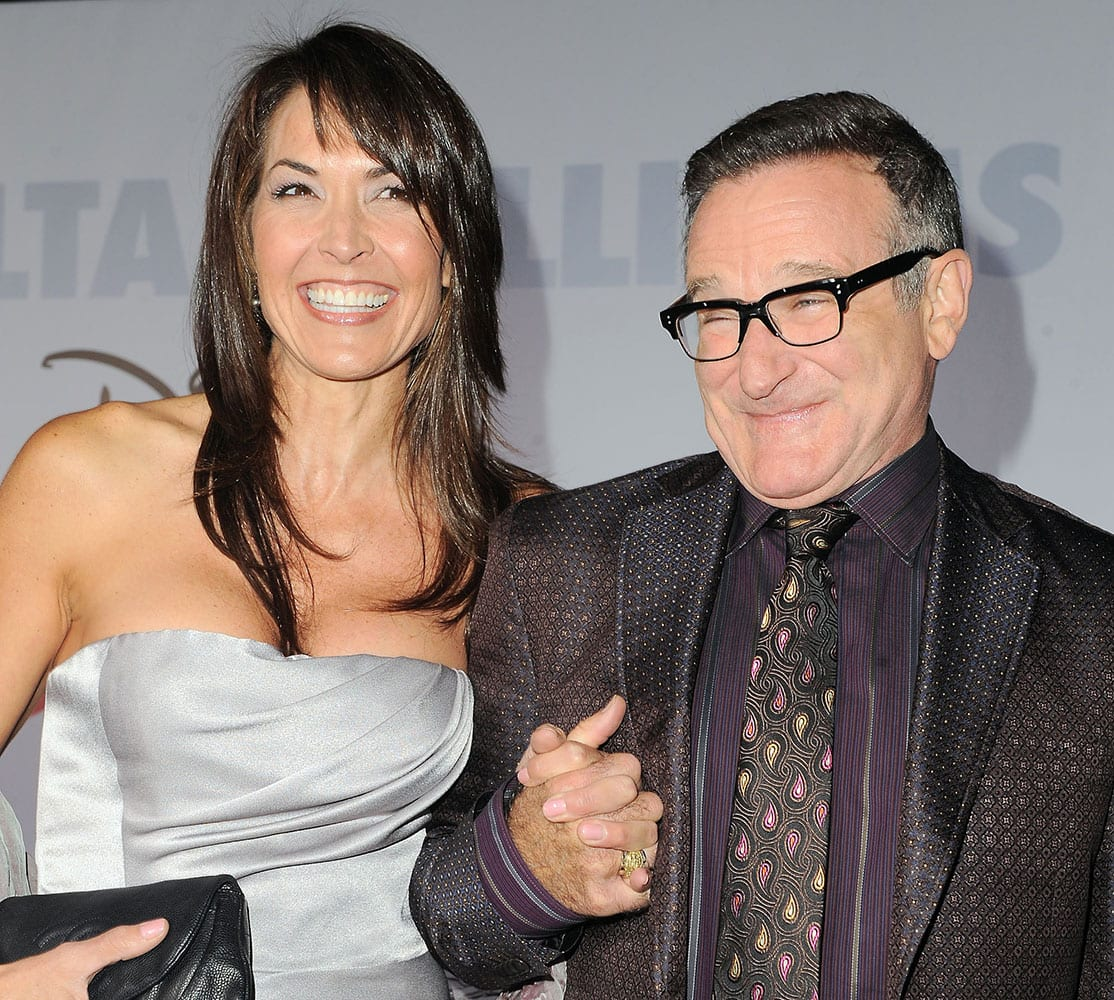 FILE - This Nov. 9, 2009 file photo shows actor Robin Williams, right, and his wife Susan Schneider at the premiere of `Old Dogs` in Los Angeles. Williams, whose free-form comedy and adept impressions dazzled audiences for decades, died Monday, Aug. 11, 2014, in an apparent suicide.