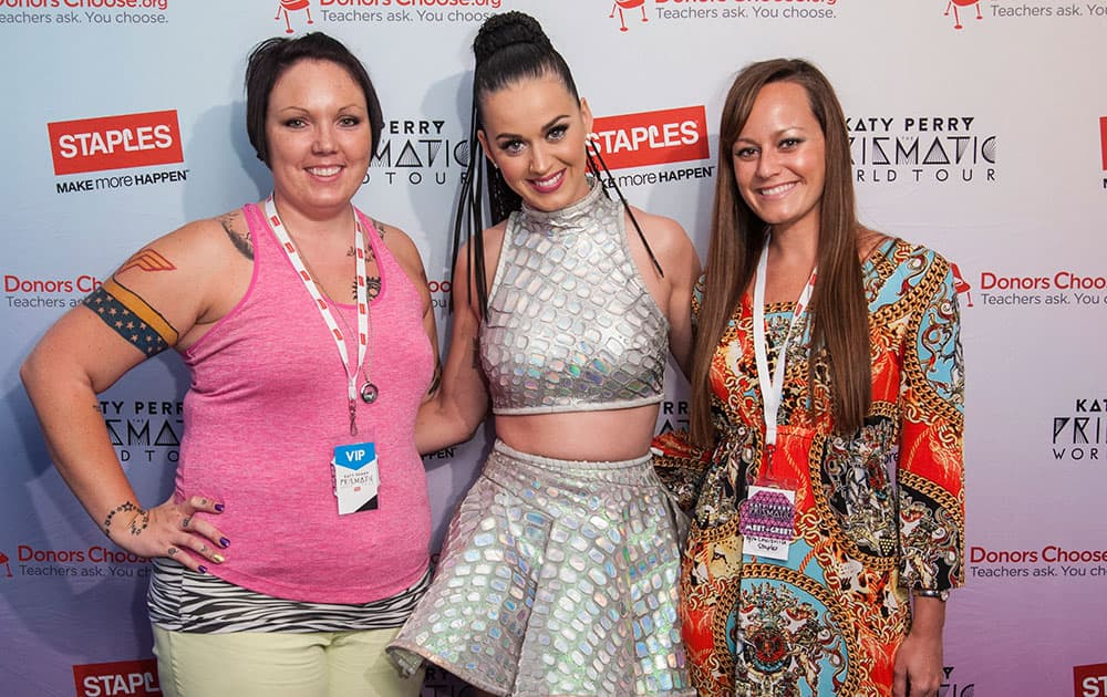 Global pop star Katy Perry, center, with local teachers, left to right, Amanda Workman and Kristie Hofelich backstage at the KFC Yum! Center during her Prismatic World Tour performance in Louisville.