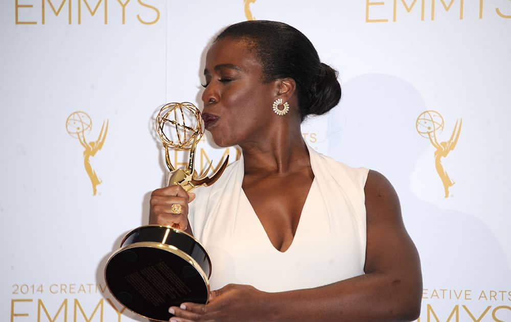 Uzo Aduba poses in the press room with the award for outstanding guest actress in a comedy series for `Orange Is the New Black` at the 2014 Creative Arts Emmys at Nokia Theatre L.A.
