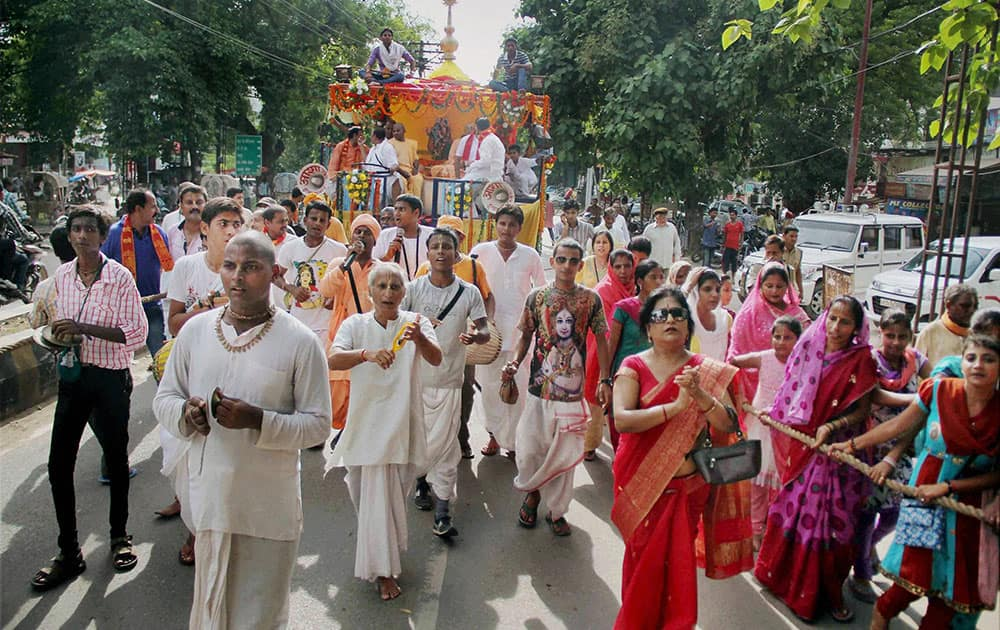 Hindu devotees take part in a religious procession during Shri Krishna Janmashtami celebrations in Allahabad.