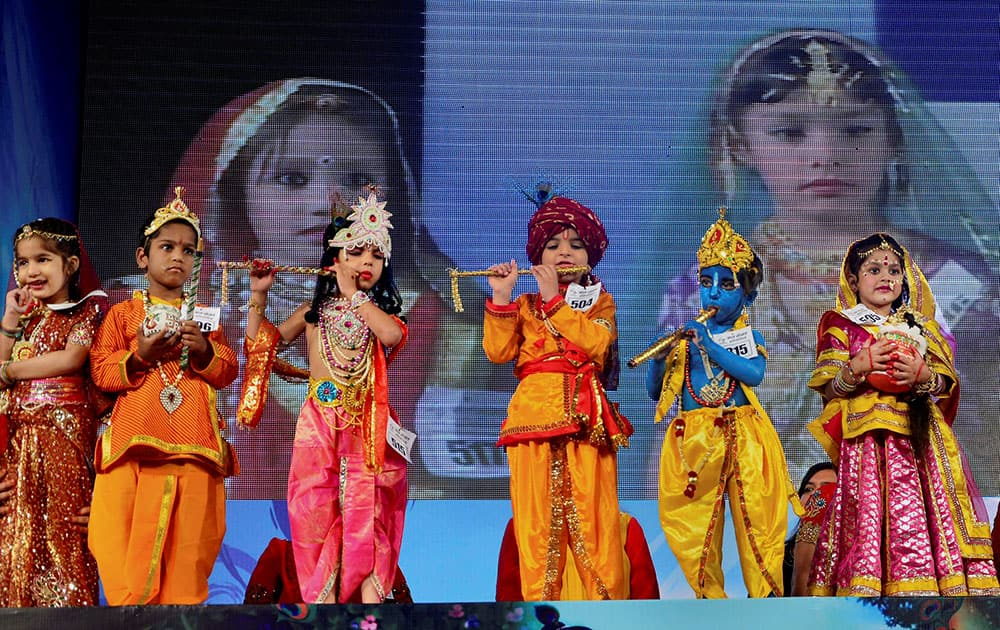 A CHILD DRESSED UP AS LORD KRISHNA AND RADHA PARTICIPATE IN `BAL GOPAL` CONTEST ON THE OCCASION OF JANAMASHTAMI FESTIVAL IN JAIPUR.