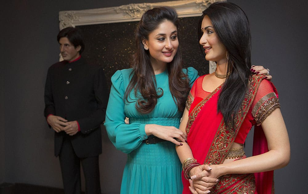Bollywood star Kareena Kapoor comes faces to face with her wax figure from 2011 after donating a new red sari with a gold trim that the actress wore from the film 'Ra.One', at Madame Tussauds in central London.