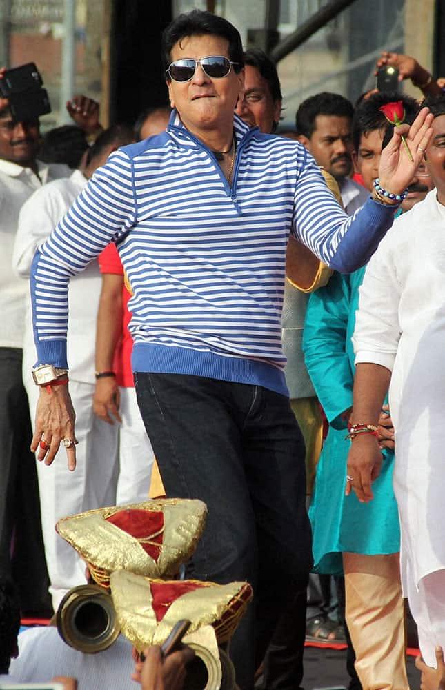 Bollywood actor Jitendra performs at the Janmashtami celebrations in Mumbai.