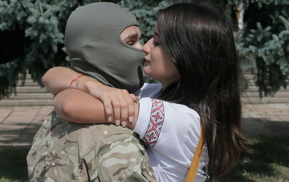 A couple shares the last kiss as they say goodbye to each other before volunteers were sent to the eastern part of Ukraine to join the ranks of special battalion `Azov` fighting against pro-Russian separatists, in Kiev, Ukraine.