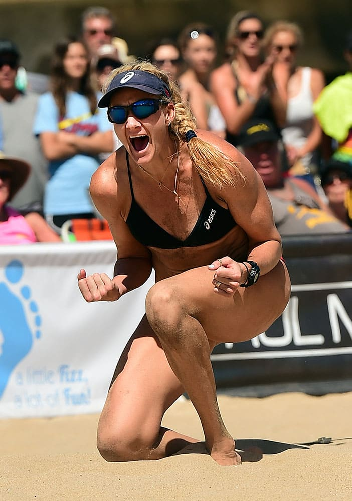 This image provided by AVP shows six-time Manhattan Beach Open champion, Kerri Walsh Jennings celebrating her semi-final Beach Volleyball victory  in Manhattan Beach, Calif.