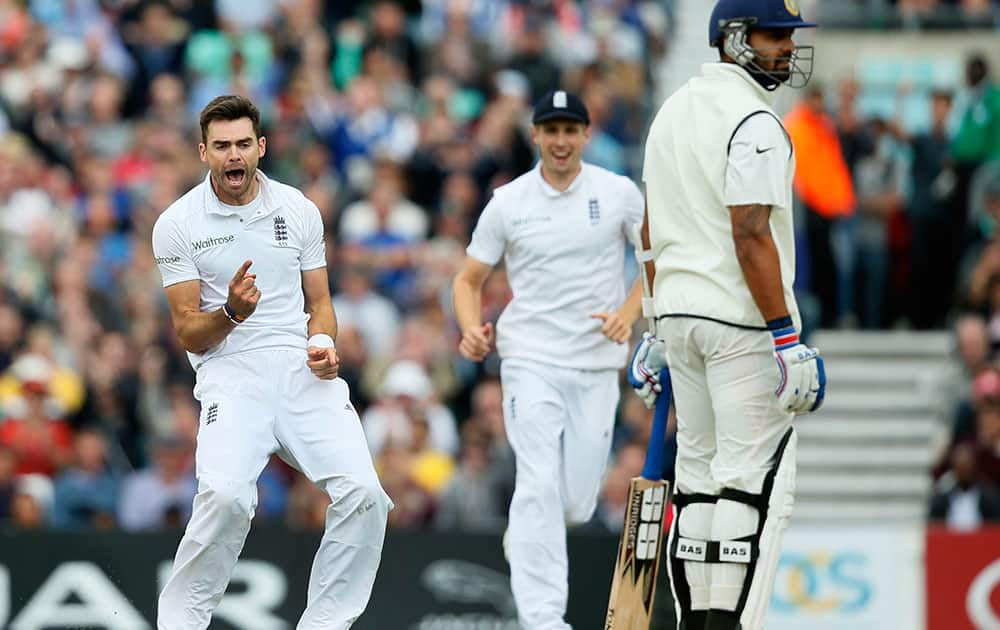 England`s James Anderson, left, celebrates after taking the wicket of India`s Murali Vijay, right, LBW, during the third day of the fifth test cricket match at Oval cricket ground in London.