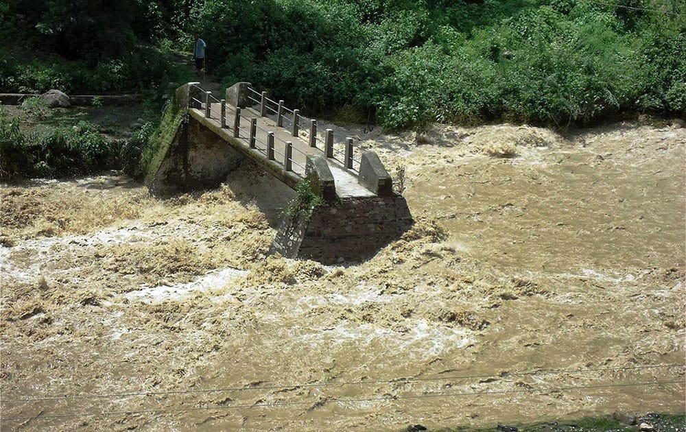 A view of a bridge which washed away after flood in Henwal river in Nagini, Tehri Gahrwal.