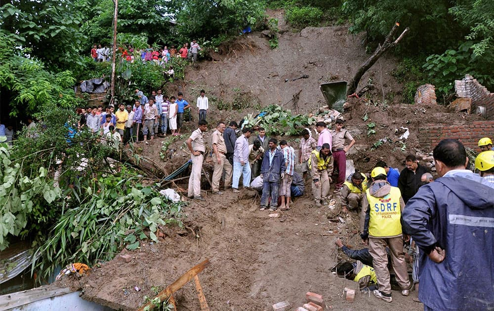 Rescue team busy in rescuing the people and dead bodies, where seven people died in a landslide at Rajpur area in Dehradun.