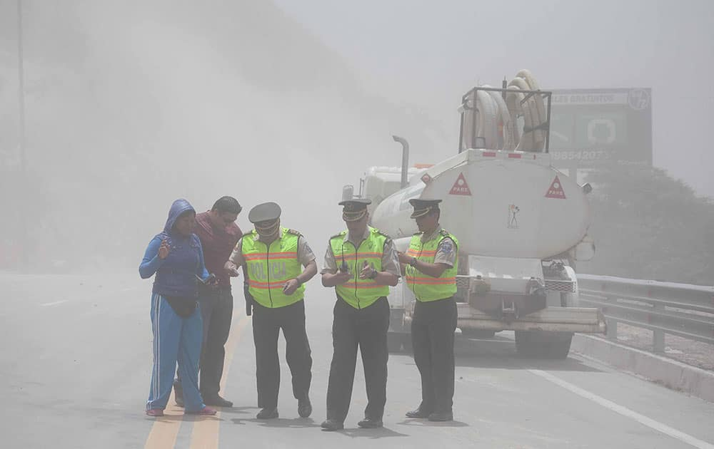 Police close traffic to the Pan-American highway as earth and dust spill on it from the hills above, after a quake struck Ecuador`s Capital. An earthquake measuring 4.7 degrees shook Quito on Saturday causing injuries and the temporary closure of the capital`s airport, according to authorities.