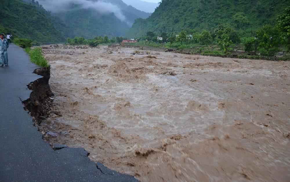 Damaged roads by overflowing Saung river at Tehri Garhwal area near Dehradun.