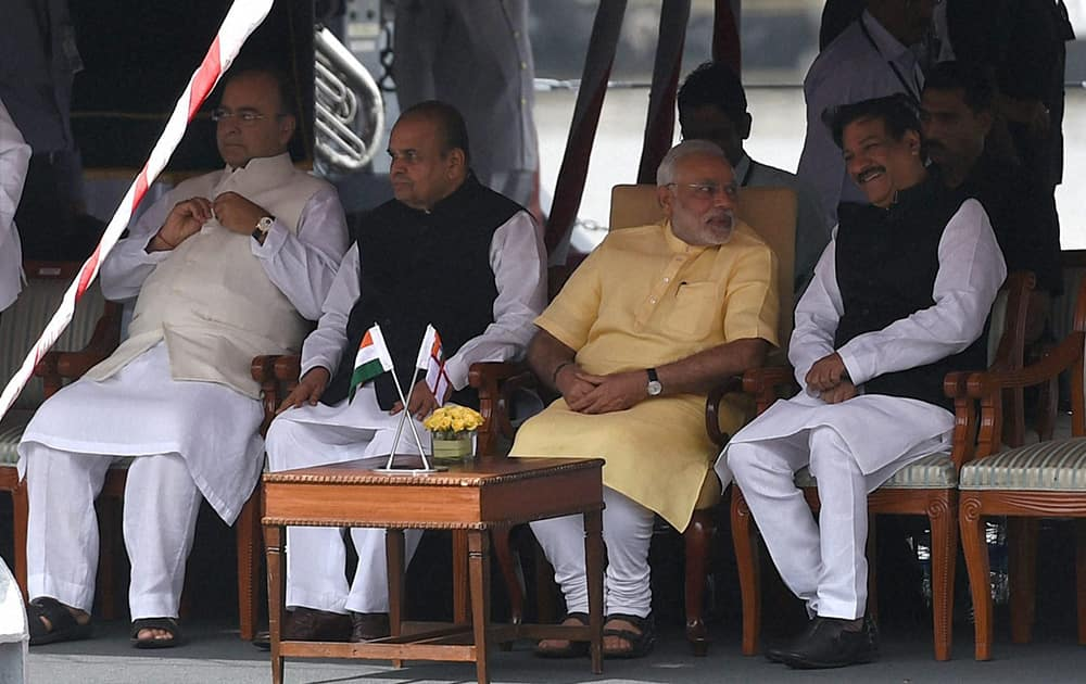 Prime Minister, Narendra Modi (3rd from right) flanked by Defence Minister, Arun Jaitley, Maharashtra Governor, K Shankarnarayanan and Maharashta Chief Minister Pritviraj Chavan during the commissioning ceremony of INS Kolkata (D63) the lead ship of the Kolkata-class guided-missile destroyers at the Naval Dockyard in Mumbai.