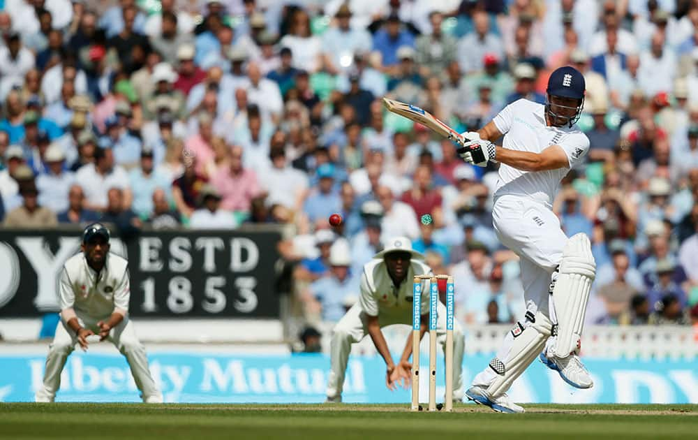 England's Alastair Cook hits a ball off the bowling of India's Ishant Sharma during the second day of the fifth test cricket match at Oval cricket ground in London.