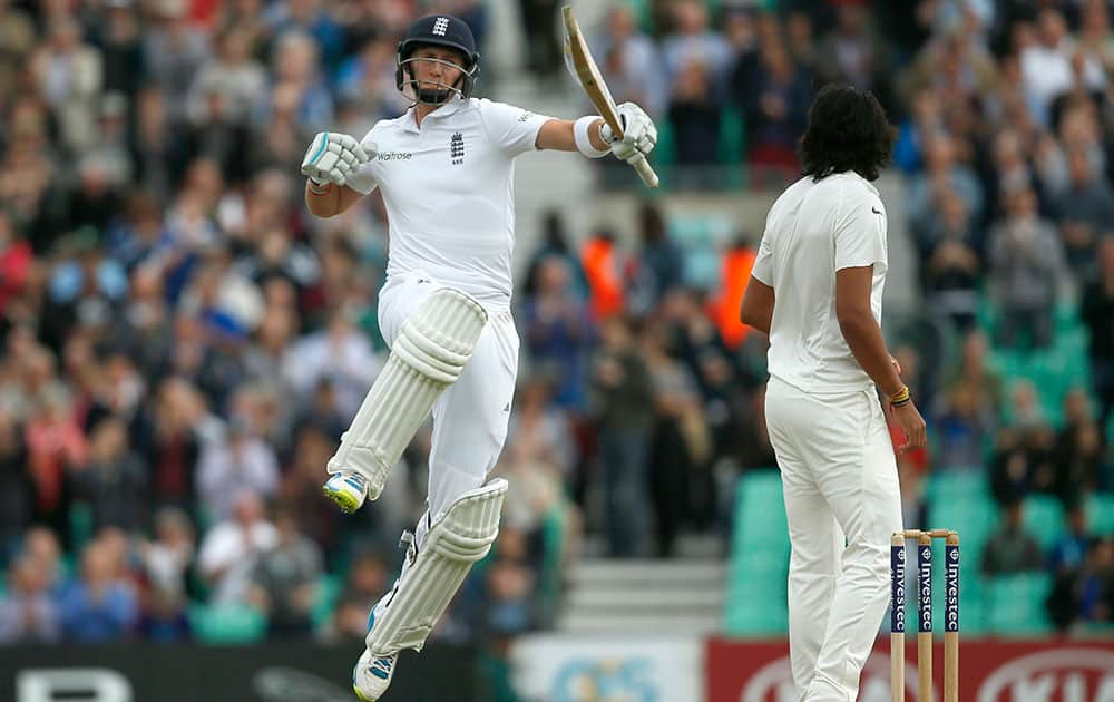 England's Joe Root celebrates scoring 100 runs not out during the third day of the fifth test cricket match against India at Oval cricket ground in London.