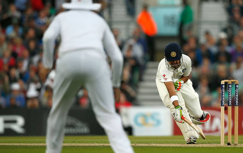 India's Gautam Gambhir is run out from a throw by England's Chris Woakes during the third day of the fifth test cricket match at Oval cricket ground in London.