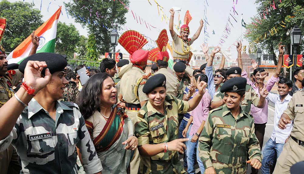 BSF personnel along with others dancing to celebrate Independence Day at the Indo-Pakistani joint check post at Attari..