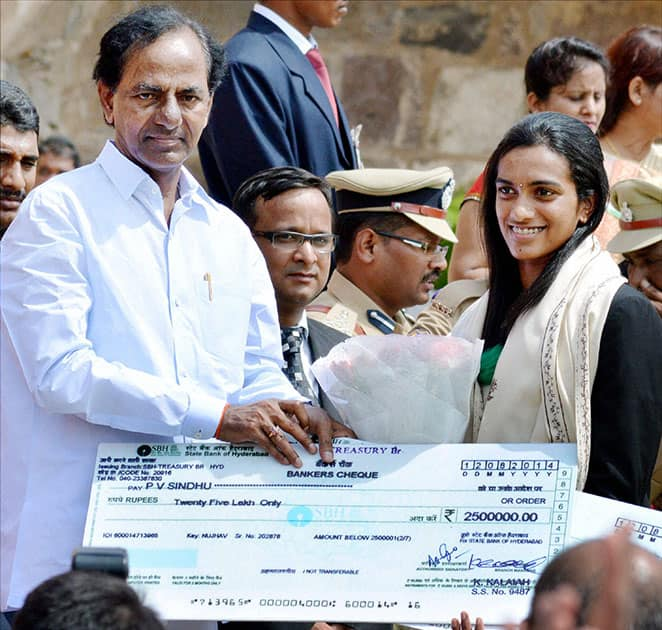 Telangana Chief Minister K Chandrashekar Rao felicitating shuttler PV Sindhu during the 68th Independence Day function at the historic Golkonda Fort in Hyderabad.