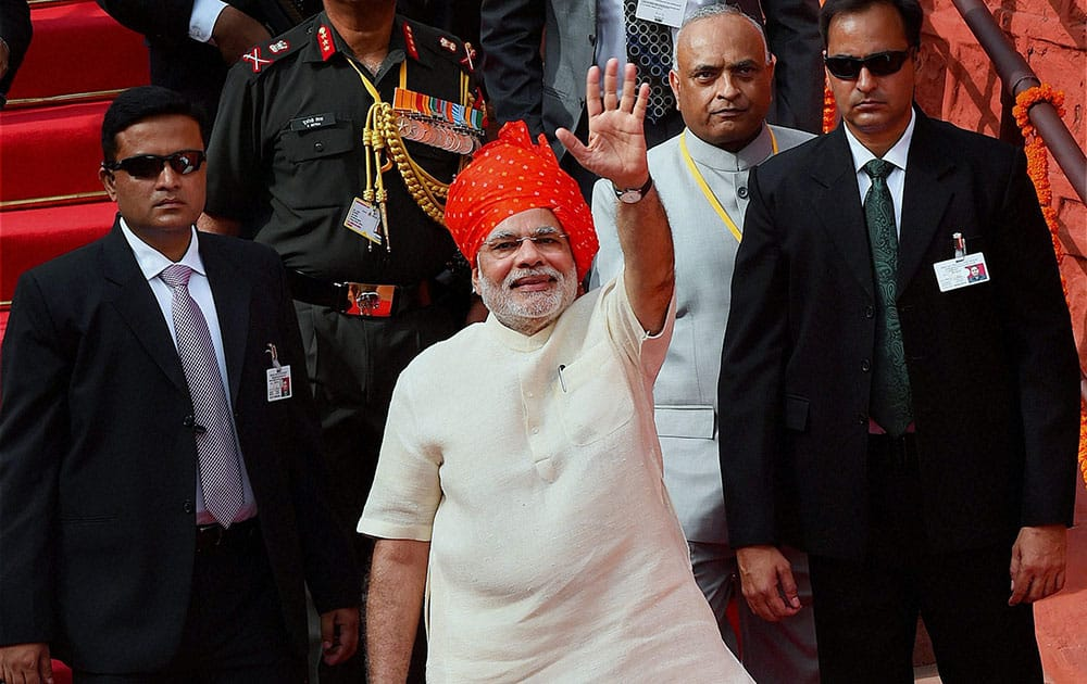 Prime Minister Narendra Modi waves after addressing the nation on the 68th Independence Day from the historic Red Fort in New Delhi.