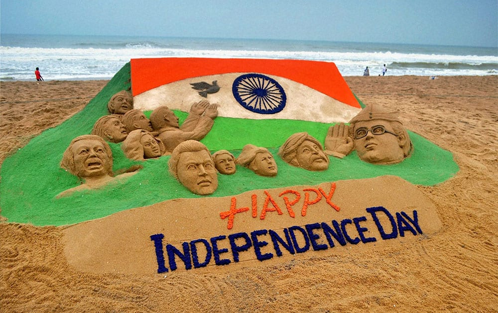 A sand sculpture on eve of Indipendance day at Puri beach.
