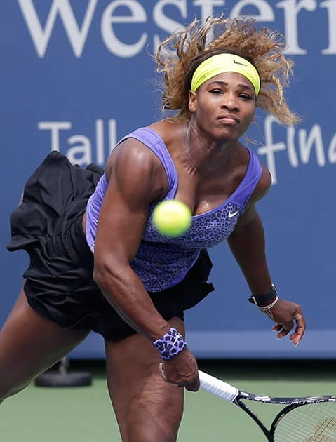 Serena Williams serves against Flavia Pennetta, from Italy, during a match at the Western & Southern Open tennis tournament.