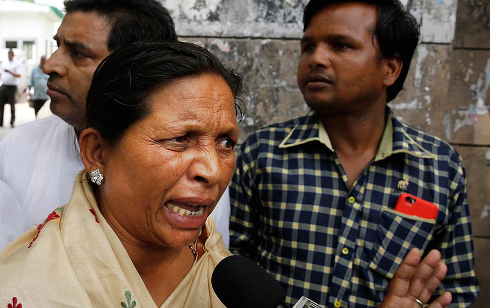 "Rukmani Devi, sister of India's famous ""Bandit Queen"" Phoolan Devi speaks to the media outside a court after judgment was passed in the murder case, in New Delhi."