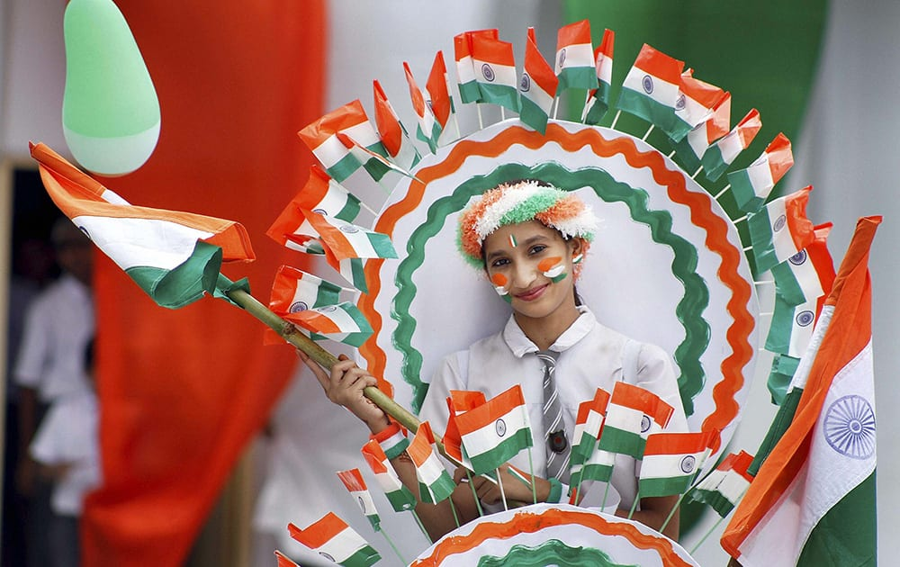 A school student at the full dress rehearsal of Independence Day parade in Ajmer.